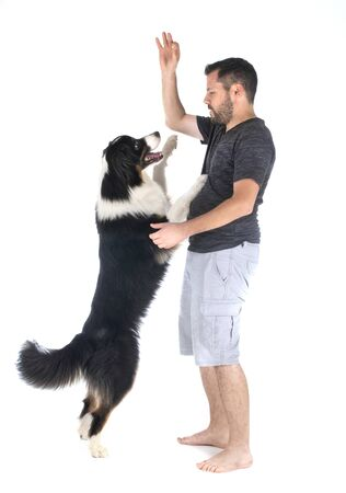 man and dog in front of white background