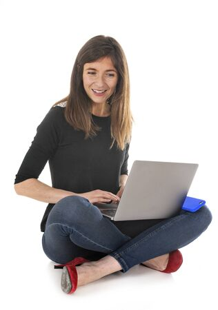woman and laptop in front of white background