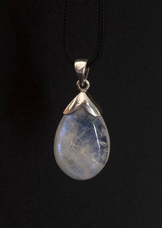moonstone in collar in front of white background