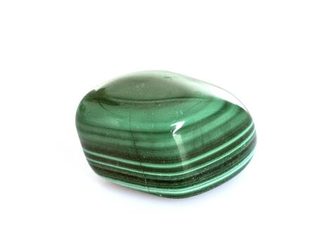 polished malachite in front of white background