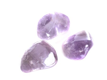 three amethysts in front of white background