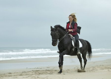 riding girl are training her horse on the beach