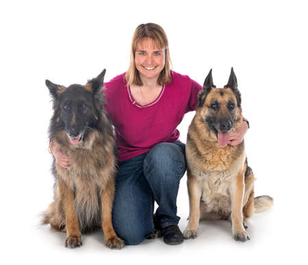 old german shepherd and woman in front of white background