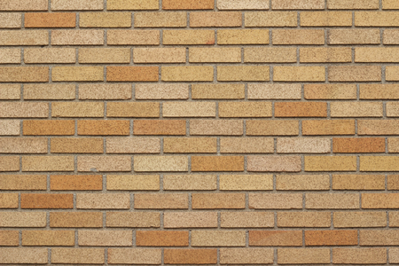 Brick wall background in varying shades of orange