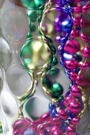 Abstract art texture background of defocused glass with colorful bokeh