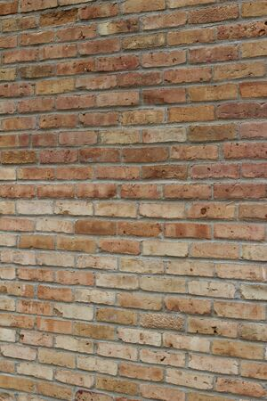 Beautiful old shabby chic beige and pepper red brick wall texture with a colorful look (angle view)