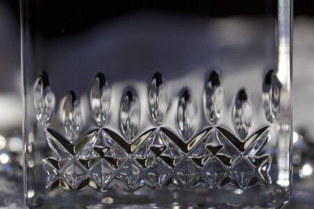 Macro abstract view of a beautiful modern lead crystal glass surface  with diamond cut accents
