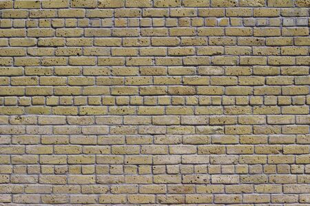 Antique shabby chic yellow beige color brick wall texture in common bond brickwork pattern