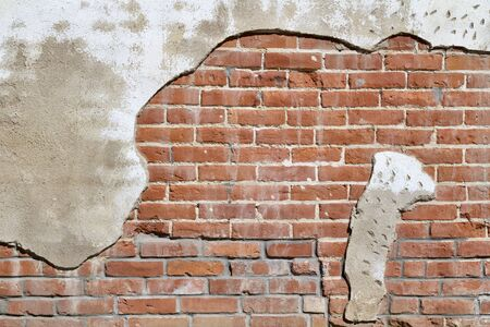 Old deteriorating white painted brick wall texture with a shabby chic appearance