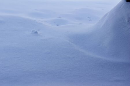 Abstract background view of fresh white drifting snow texture