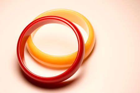 Close up view of vintage bakelite (baekelite) bangle braceltets on white background, with copy space