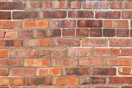 Rustic red brick wall background with attractive texture from age and weathering