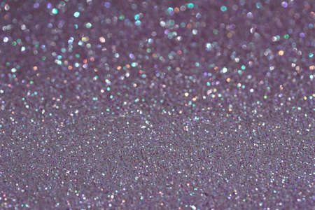 Shimmering white glitter texture background with bokeh