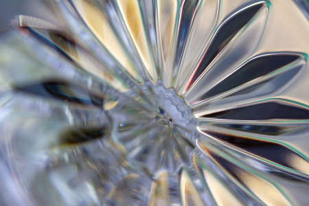 Macro abstract art background design of beautiful defocused lead crystal glass texture with hand cut fan shape facets