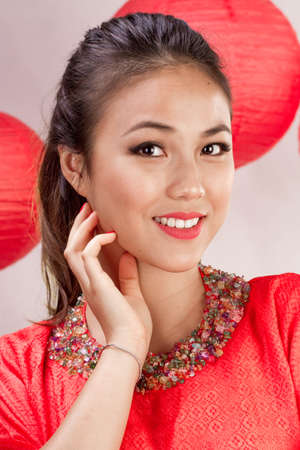 fashion model with red dress and red lantern Banco de Imagens