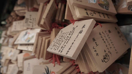 wooden wishing plaques in a Japanese shrine 報道画像