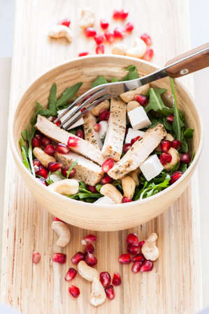 Delicious rucola salad with turkey and pomegranate photo