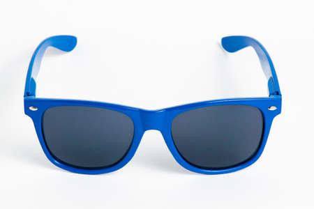 Blue plastic sunglasses isolated on white background photo
