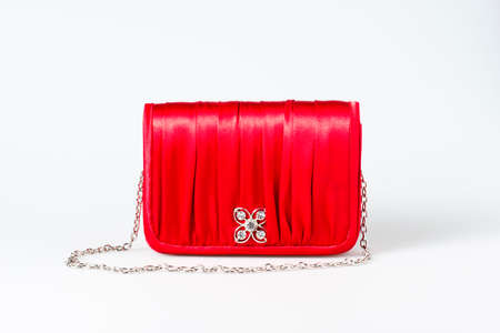 Woman little red purse on white background photo