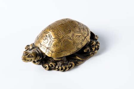 Feng shui golden metal turtle for decoration  photo