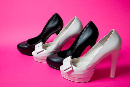 leather woman: Leather woman shoes isolated on pink background Stock Photo