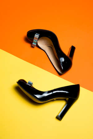 leather woman: Leather woman shoes isolated on yellow background Stock Photo