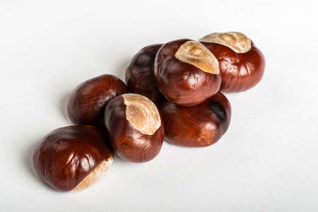 Set of delicious chestnuts on white bacground photo