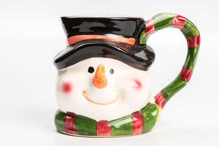 Christmas tea mug with snowman on white background photo