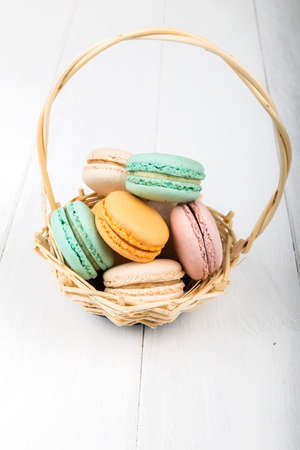 ganache: Set of macarons isolated on white wooden table Stock Photo