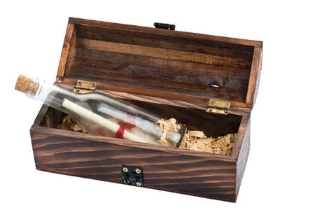 message bottle: Dark wooden chest with message bottle