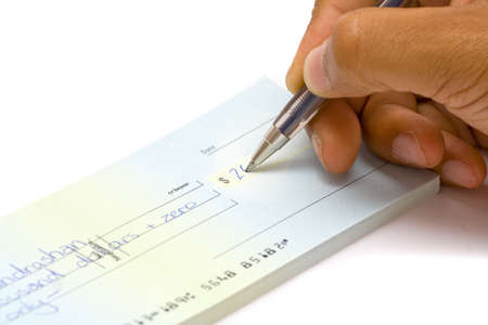 blank check: A hand signing a Cheque Stock Photo