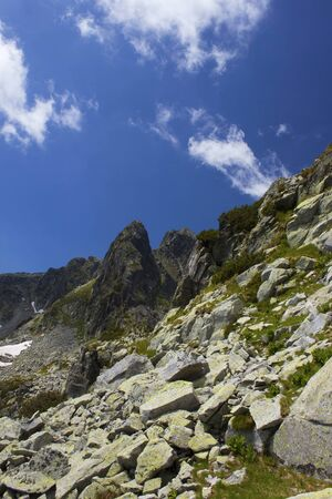 Vertical view of mystical rocky Retezat mountains in Romania, in the summer atmosphere.