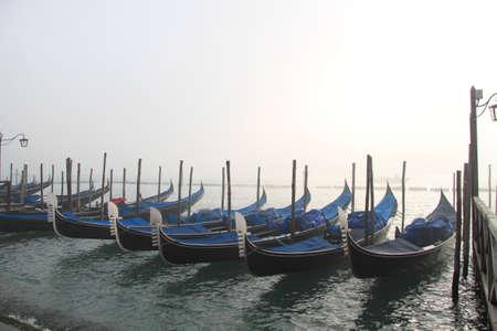 gondoliers: Gondolas on a canal in Venice Stock Photo