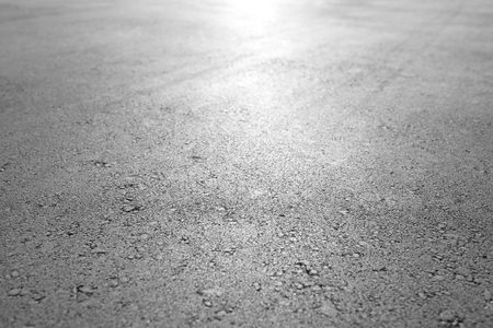 bumpy road: Asphalt background texture Stock Photo