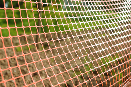 Plastic safety net for construction site. Construction mesh.
