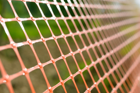 wired: Plastic safety net for construction site. Construction mesh.