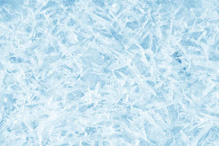 Ice background texture. Ice with different shapes and cracks.