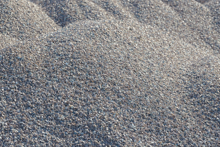Breakstone background. Road gravel. Gravel texture. Crushed Gravel background. Piles of limestone rocks. Break stones on construction site. Imagens