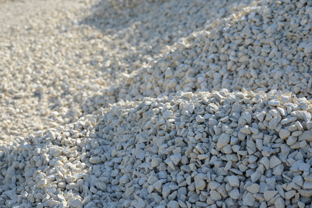 Breakstone background. Road gravel. Gravel texture. Crushed Gravel background. Piles of limestone rocks. Break stones on construction site.