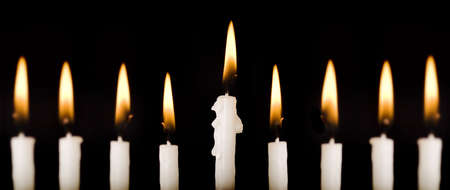 Beautiful lit hanukkah candles on black.  Super black background.  Carefully spotted and retouched.  High resolution images shot with a 100 mm macro lens.   Stock Photo