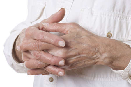 clasping: Senior womans hands isolated on white background Stock Photo