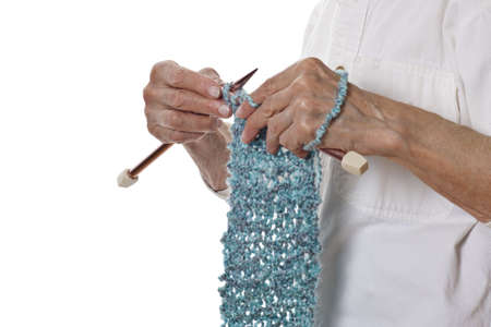 senior womans hands knitting photo