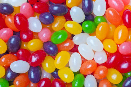 jelly beans multi colored backdrop or background Stock Photo