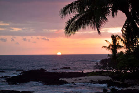 Coastal view on the Big Island of Hawaii with lava rocks at sunset photo