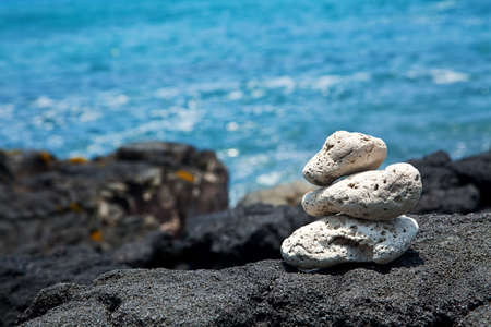 White Zen rocks on Hawaiian coastline with lava Stock Photo - 5225553