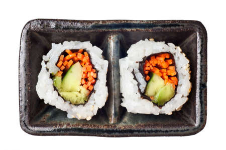 metallic seaweed: Vegetarian sushi California roll with rice and seaweed isolated on white background Stock Photo