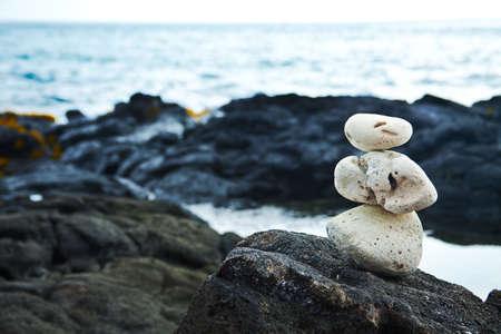 kona: White Zen rocks on Hawaiian coastline with lava Stock Photo