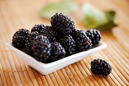 bamboo mat: blackberries isolated on a bamboo mat background