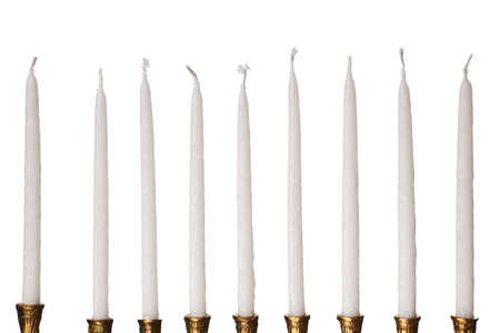 Hanukkah menorah candles isolated on a white background photo