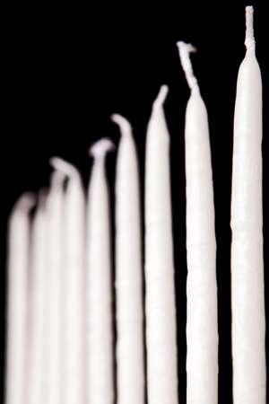 white hanukkah candles on a black background photo